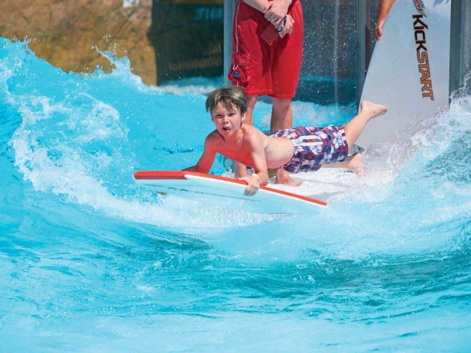 Boy surfing in pool