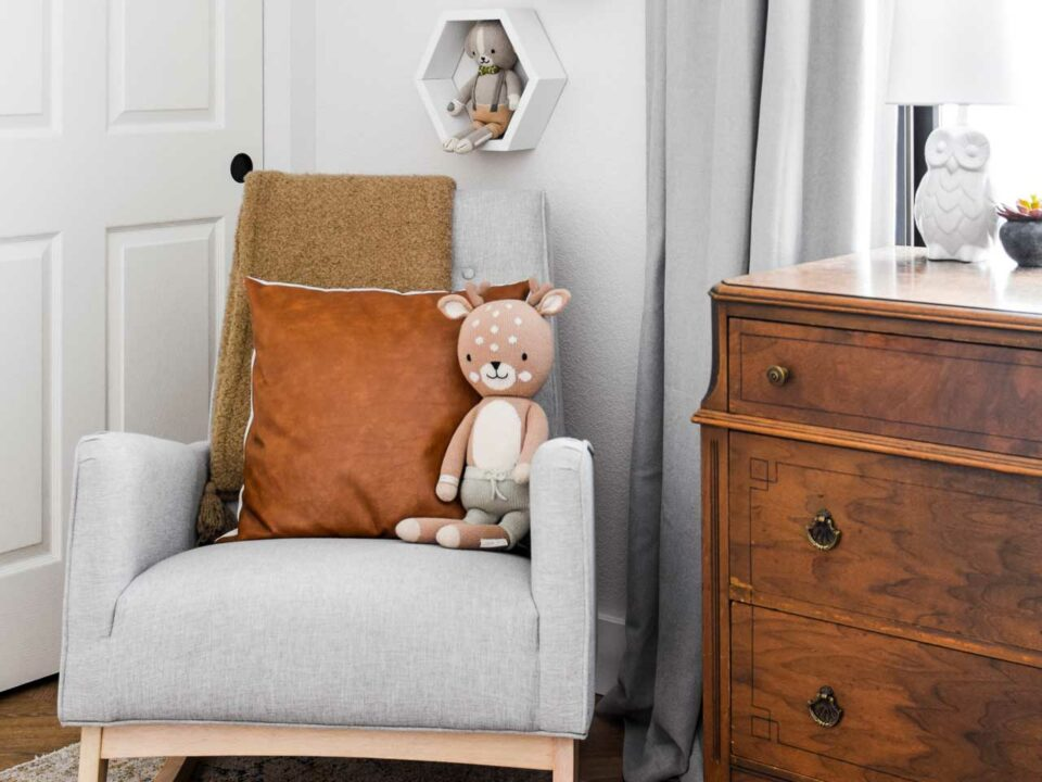 Stuffed animal on neutral gray chair